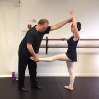 Mr. Alex working with a student in his Tuesday ballet class.