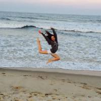 Kaylie jumping on the beach, always dancing!
